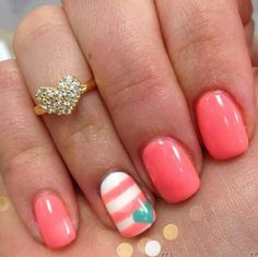 Coral and turquoise nails. Perfect to match out SENIOR SWEATERS!!!
