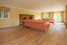 Winchester Antique engineered oak wood flooring with an aged and distressed surface to replicate a reclaimed oak board. Fitted throughout ground floor of large new home in Sunningdale Berkshire
