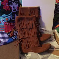 Minnetonka calf-hi 3 layer boots Brown calf hi boots never worn. Minnetonka boots just don't feel right on my feet. Minnetonka Shoes Moccasins