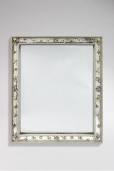 Miroir en bois laqué gris, par Jean-Charles Moreux, vers 1936.  Grey lacquered wood mirror by Jean-Charles Moreux, circa 1936.