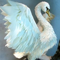 Lovely paper swan in an Anthroplogie Holiday window display - Boca Raton, FL via Anthro Blog