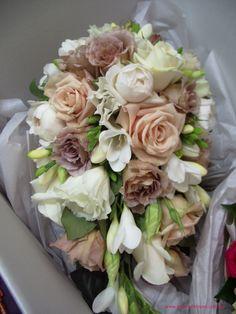 BG120 Teardrop bouquet with `Sahara` roses, latte `Julia` roses, white David Austin roses, white lisianthus, white freesias, ivory `Marathon` roses