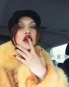 Bella Hadid - yellow fur + red lip