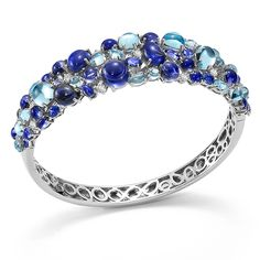 Shanghai bracelet in 18kt white gold with iolites, blue sapphires, blue topazes and diamonds.by Roberto Coin