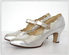 vintage 20s heels 7.5 // 1920s silver heels 7 // 20s metallic silver heels // flapper heels 8. $148.00, via Etsy.