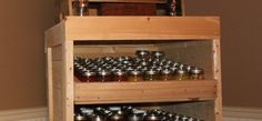 http://oldworldgardenfarms.com/2012/07/20/using-pallets-to-build-a-canning-pantry-cupboard/