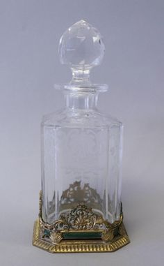 Sold for $250 in 2013   19TH CENTURY BACCARAT AND ENAMEL PERFUME BOTTLE