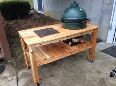 Big Green Egg Table.   This design was built on the fly from western red cedar.   It's based on the rough dimensions of an XL BGE so the XL table cover fits.  With the casters; the total cost was about $250.
