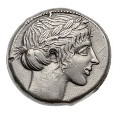 Tetradrachm of Leontinoi with head of Apollo - Greek Period Classical Period | 466–422 B.C. | Obverse: Head of Apollo to right, hair turned up behind, and bound with a laurel wreath which has three overlapping rows of leaves. Five curls on forehead, border of dots. Reverse: Lion's head to right with open mouth, tongue protruding. Around it four barley-corns. Inscription in Greek around.