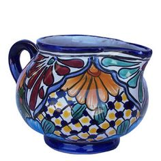 A hacienda talavera creamer belongs to our rustic home decor category. Its green and blue pattern painted over white background will add warmth to the living space. by Rustica House #myRustica