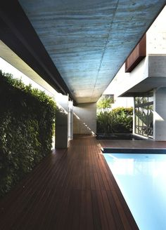 Gorgeous Ideas about Growing Home Concept: Fascinating Wooden Deck Design At The The Apartment House Nearby The Swimming Pool And Fresh Vert...