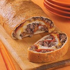 Pepperoni Stromboli Recipe..made a few changes to fit my family...added small amt of pizza sauce, added canadian bacon,did not use onions, and used sausage instead of hamburger so it was more pizza like.  Use Pillsbury crusty french bread loaf, just unroll and fill.