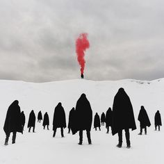 A red pillar of smoke rose up from the figure on the hill. It was striking against the white, clean snow and the matching sky. The cloaked ones walked towards it as if it was magnetic.