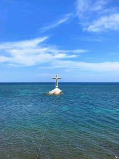 Sunken Cemetery in Camiguin Island, Philippines is a mark of swept remains of departed locals driven underwater when Mt. Volcan erupted in 1871. This Cross were mounted later on to remind the locals and tourists of what it used to be and as an attraction too. Camiguin Island is in Mindanao, one of the major 3 islands of the Philippines.