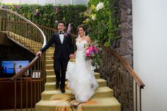 Bride and Groom making their grand entrance down our lovely floral wall stairway at The Kahala! #atthekahala #kahala #wedding #bride #grandentrance #hawaiianwedding #hawaii Photo Credits: Eugene Kam Photography