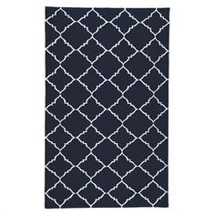 Flatweave wool rug with a trellis motif. Handmade in India.  Product: RugConstruction Material: woolColor: Dark BlueFeatures:  ReversibleIndia  Note: Please be aware that actual colors may vary from those shown on your screen. Accent rugs may also not show the entire pattern that the corresponding area rugs have.Cleaning and Care: Vacuum regularly with non-beater attachment. Blot stains immediately. Test cleaning products in discreet area. Dry clean.