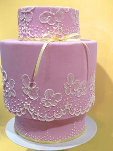 pink cake, yellow ribbon