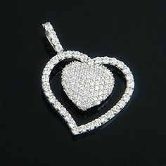 Beautiful Heart Jewelry! This 14K Gold Designer Diamond Heart Pendant showcases 1.17 ctw of sparkling round diamonds, each masterfully pave or prong set in a lustrous gold frame. Featuring a fully encrusted design and a highly polished gold finish, this dazzling diamond heart pendant is available in 14K white, yellow and rose gold.