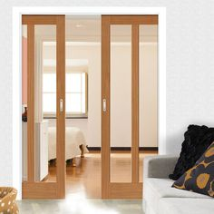 Double Pocket Montana Matterhorn 2 Pane Oak sliding door system in three size widths with Clear Glass. #glazedpocketdoors #glazedroomdividers #internaloakpocketdoors