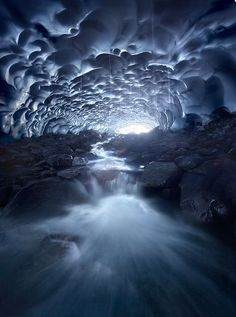The Deep Blue ~ by  Marc Adamus ~   A waterfall inside a 10m high, 100m long snow cave. Not something I get to see every day.