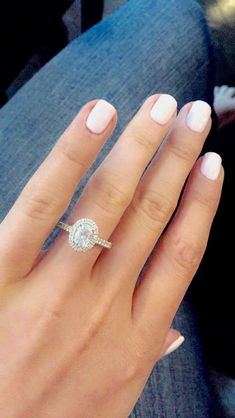 1.65 carat TW oval halo engagement ring