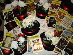 Easy way to decorate with a broadway theme.  -  Top Hap and Flowers centerpiece with Playbill Table signs
