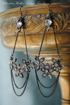 Sweet old Art Deco rhinestone flowers in the shape of crescents drop from chains, sterling ear wires, and more vintage rhinestones. Very