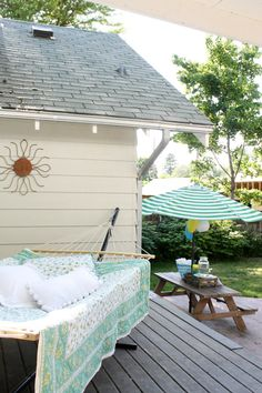 Seasonal Simplicity Home Tour - Our Outdoor Spaces; love the quilt on the hammock