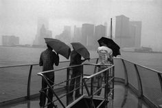 New York City. Ferry directed to Staten Island. In the background: Battery Park (Manhattan). 1981. © Raymond Depardon / Magnum Photos. July 4, 1981. New York. It rains, it rains. It is Independence Day, a holiday, the city is empty. A visit to the...
