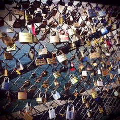 love-locks on a bridge in paris! you write your names on a lock and throw the key in the water. bucket list material!