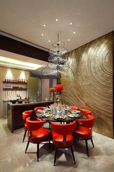 Love the tree-ring walls the red dining room chair and the great chandelier