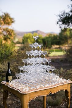 A pyramid of champagne coupes on Archive Rentals Carleigh table looks like it is straight out of a movie   Photography: Samuel Lippke - samuellippke.com/studio/index.html  Read More: http://www.stylemepretty.com/california-weddings/2014/04/28/romantic-tuscan-wedding-inspiration/