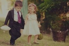 aw, so cute! ring bearer and flower girl pic.. want this with Emma and Liam! :)