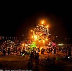 The best sound stage I've ever seen.  This was Nexus 2010.  They had a cauldron of flame under the geodesic sphere which sports 91 computer controlled flame spinerettes.  The dome on the left houses a tesla coil, and the flags in back are rising from a sweet-as-shit jungle gym.