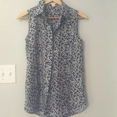 Jcrew floral button down tank This is a really cute button down blouse. It is flowy, not fitted and made of 100% polyester. Only worn once. I'm 5'4 and it felt a little long if I wore it untucked. J. Crew Tops Blouses