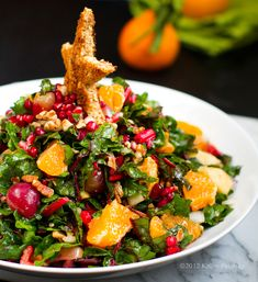 What a gorgeous and healthy way to spread some holiday cheer! Christmas Tree Salad. Pomegranate. Pecans. Raw Chard. Look at that little toast star! (I'm going to borrow that for other festive dishes, too!) #vegan