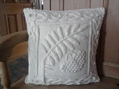 I love Barb Pott's designs, they are so creative. The only change I made to the pattern was to add a small piece of Icord to connect the leaf stem and the cable border; it covers the stitched...