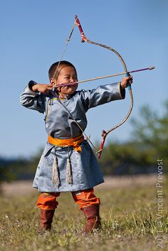 "Young Mongolian archer at Nadaam festival in Tsagaannuur, Mongolia. Naadam is properly know as ""Eryn gurvan naadam,"" after the three manly games of wrestling, horse racing, and archery making up the core activities of the National Festival. Traditional Archery, China, Central Asia, World Cultures, People Around The World, Beautiful Children, Little People, Cute Kids, Martial Arts"