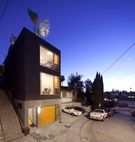 """Nicknamed the """"Eel's House"""" after the narrow urban properties of the same name in Japan, this slimhome in Los Angeles's Echo Park squeezes agarage, architecture studio, open-plankitchen and living room, patio, and moreinto four levels.  Courtesy of: Anonymous Architects"""