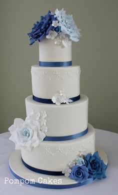 Ivory wedding cake with blue roses |  Its not square but it would look as a square cake!