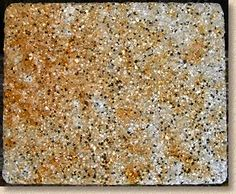 Rust staining on silver-grey granite block cuased by mosskiller spillage