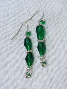 "Gorgeous green faceted glass beads and tiny silver shamrock dangles say, ""Happy St. Patrick's Day!"" or just show your love for all things green. Pierced Earrings  Erin Go Bragh Emerald Green Faceted Glass"