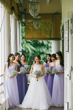Bridesmaids in shades of lilac with baby's breath bouquets // Jun Wei and Sharon's Intimate Wedding at Suffolk House, Penang