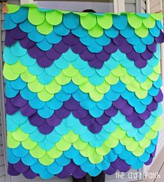 """Make an amazing mermaid blanket with the help of this detailed, step-by-step tutorial. This blanket is unique, colorful and so much fun! Or it could be a """"dragon scale"""" blanket if that's more your speed."""