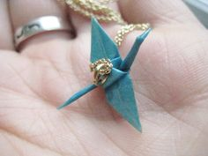 I've also seen these Origami Crane necklaces in Gold but I dig the varnished paper!