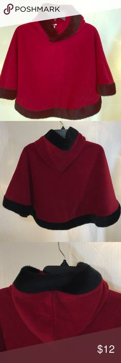 Christmas Glamour Cape . Size Med. 5-6 Christmas velvety red with black furry trim.  This dressy cape would fit a pre-teen well. 6 to 9 year old. It is a slip over with a fur trimmed hoodie. It is in excellent pre-owned condition and free and clear of any flaws. Minimal wash or wear. Ships next business day. U S giftwear Jackets & Coats Capes