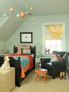 love the map shade, solar system, leather chair... perfect boys room.