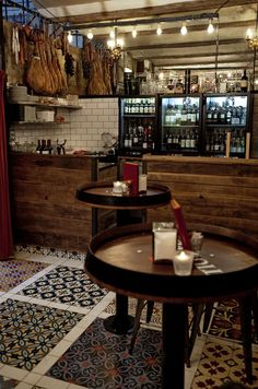 Loooove how they created this pattern with mixed tiles. Very cool idea. (image from Bar Pepito)