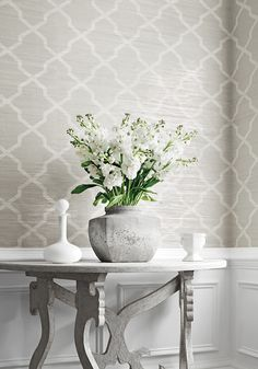 Carolyn Trellis Wallpaper A smart wide width horizontal paperweave with a trellis design printed in white and pale grey on a natural beige ground, and interspersed with metallic silver foil strands. The design has been printed with a subtle weathered effect for added texture and interest.