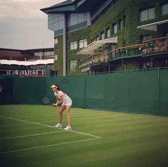 Ana Ivanovic practises outside Centre Court.
